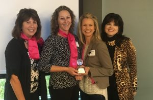 Nicole Brusewitz, Vice President of Education and Events at the Mountain West Credit Union Association, receiving the first ever Emerging Leader Award awarded by the Global Women's Leadership Network. Pictured from left-to-rightNancy Herbert, Nicole Brusewitz, Calyn Ostrowski, and Sara Canepa Bang.